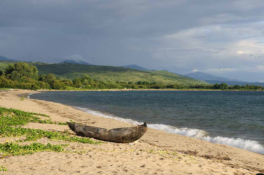 Tanzania, Malawi lake is the Worlds longest and second deepest fresh water lake, it is also one of the oldest lakes on the planet. The picture presents beautiful sand beach and traditional dugout canoe